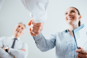 top job candidate shaking employers hand