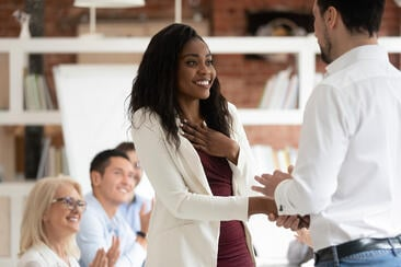 employee is thrilled when manager congratulates her and shows his appreciation