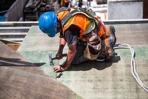 construction worker takes safety precautions to prevent injury during National Safety Month