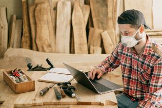 Carpenter wears mask to protect himself from dust inhalation and COVID-19