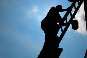 man-climbing-ladder-to-paint.jpg
