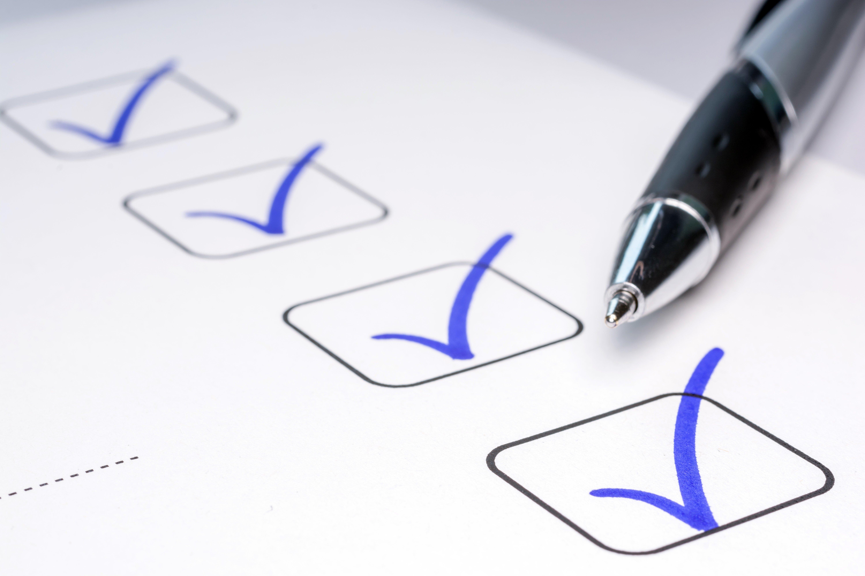 Four blue verification check marks