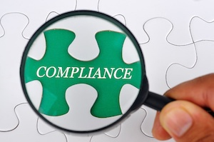 magnifying-glass-hr-compliance.jpg